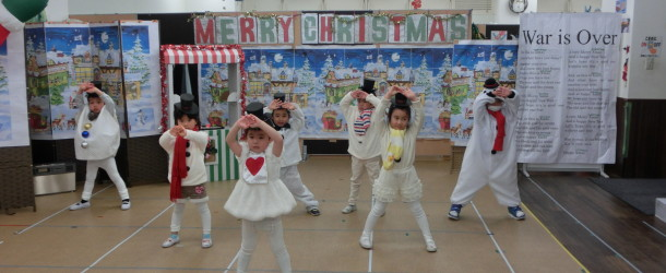 Kailua 4 and 5-year old kindergartners perform their dance version of Jingle Bell Rock.  © Kailua International School