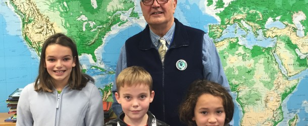 Host Calvin Grosshuesch is shown with 2015 winners of the National Geographic Bee (Geobee). From left, first place winner; Madison McCartney (grade 5) and second place winner; Kenshin Dean (grade 5). Josiah De For (center) was the winner in the homeschool division. © Steve Parker